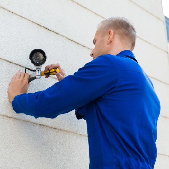 technician installing security cameras
